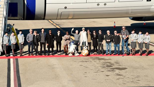 """LOS ANGELES, CA - DECEMBER 15:  Following the world premiere in Hollywood of Lucasfilms """"Star Wars: The Force Awakens"""", the film's stars were joined by J.J. Abrams and producer/Lucasfilm president Kathleen Kennedy for a chartered flight from Los Angeles to the London premiere of the movie on a custom, one of a kind, specially themed R2-D2 ANA JET. Earlier at the premiere, stars posed for photos with a scale model of ANAs BB-8-themed ANA JET. ANA, Japans largest airline, has designed three Star Wars-themed jets in celebration of Star Wars: The Force Awakens. The R2-D2 ANA JET is the first ever aircraft in the world to feature a Star Wars character on its exterior and is a product of an agreement between ANA and The Walt Disney Company (Japan) Ltd. First unveiled at the Star Wars Celebration in Anaheim, Calif. earlier this year, the R2-D2 ANA JET, a Boeing 787-9, started its regular flight in October and now flies to various destinations, including Europe, Asia, China and the U.S. December 15, 2015 in Los Angeles, California.  (Photo by Alberto E. Rodriguez/Getty Images for Disney)"""