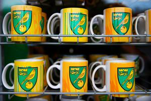 NORWICH, ENGLAND - JANUARY 23:  Norwich City mug cups are on sale at the official marchandise prior to the Barclays Premier League match between Norwich City and Liverpool at Carrow Road on January 23, 2016 in Norwich, England.  (Photo by Clive Mason/Getty Images)