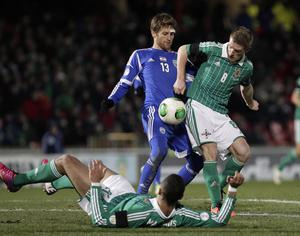 Northern Ireland's Steven Davis with Israel's Sheran Yeini during Tuesday night's World Cup qualifier at Windsor Park, Belfast