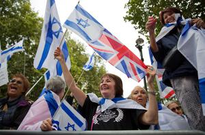 Pro-Israeli demonstrators carry the Israeli flag and Union flag as they rally in support of the planned visit of Israeli Prime Minister Benjamin Netanyahu outside the gates of Downing Street in London on September 9, 2015. Over 100 pro-Israeli demonstrators and hundreds of pro-Palestinian activists rallied in front of Downing Street in London ahead of a planned visit of Israeli Prime Minister Benjamin Netanyahu. Netanyahu visits Britain this week for talks with his counterpart David Cameron as the right-wing Israeli leader faces diplomatic pressure over West Bank settlements and stalled peace efforts. AFP PHOTO / JUSTIN TALLISJUSTIN TALLIS/AFP/Getty Images