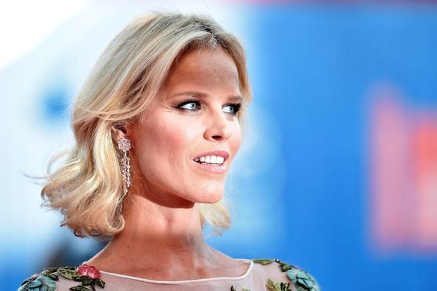 "Model Eva Herzigova arrives for the premiere of the movie ""Nocturnal Animals"" presented in competition at the 73rd Venice Film Festival on September 2, 2016 at Venice Lido. / AFP PHOTO / TIZIANA FABITIZIANA FABI/AFP/Getty Images"