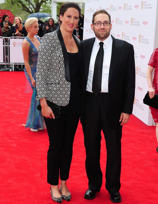 Miranda Hart and guest arriving for the 2013 Arqiva British Academy Television Awards at the Royal Festival Hall, London. PRESS ASSOCIATION Photo. Picture date: Sunday May 12, 2013. See PA story SHOWBIZ Bafta. Photo credit should read: Ian West/PA Wire