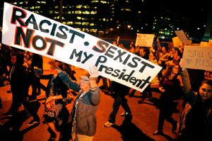 Demonstrators protest the election of President elect Donald Trump in Denver, Colorado on November 10, 2016. / AFP PHOTO / Jason ConnollyJASON CONNOLLY/AFP/Getty Images