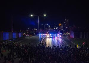 MINNEAPOLIS, MN - NOVEMBER 10: Police block protesters of President-elect Donald Trump from marching further down the I-94 on November 10, 2016 in Minneapolis, Minnesota. Thousands of people across the country have taken to the streets in protest in the days following the election of Republican Donald Trump over Democrat Hillary Clinton. (Photo by Stephen Maturen/Getty Images)