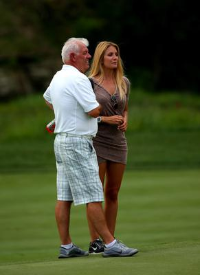 LOUISVILLE, KY - AUGUST 05:  (L-R) Gerry McIlory, father of Rory McIlroy (not pictured) talks Gala Alten, girlfriend of Pablo Larrazabal (not pictured) during a practice round prior to the start of the 96th PGA Championship at Valhalla Golf Club on August 5, 2014 in Louisville, Kentucky.  (Photo by Mike Ehrmann/Getty Images)