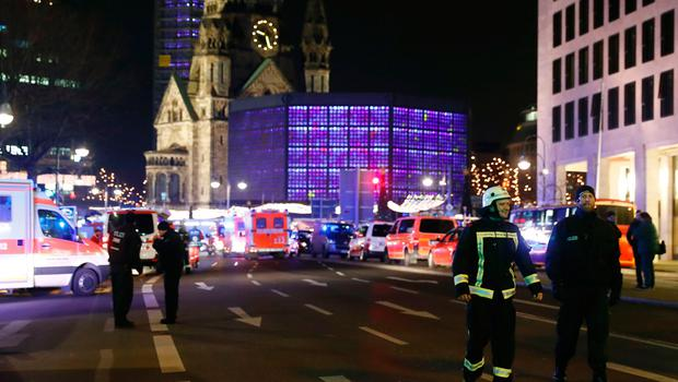 Rescue forces stand near the site where a truck speeded into a christmas market in Berlin, on December 19, 2016 killing nine persons and injuring at least 50 people. / AFP PHOTO / Odd ANDERSENODD ANDERSEN/AFP/Getty Images