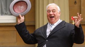 Comedian Roy Hudd holds his OBE for services to entertainment (Stefan Rousseau/PA)