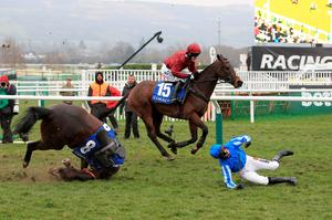 Jockey Nico de Boinville is a faller from Rolling Star during the Coral Cup on Ladies Day on Ladies Day during the Cheltenham Festival at Cheltenham Racecourse. PRESS ASSOCIATION Photo. Picture date: Wednesday March 11, 2015. See PA story RACING Cheltenham. Picture credit should read: Nick Potts/PA Wire. RESTRICTIONS: Editorial Use only, commercial use is subject to prior permission from The Jockey Club/Cheltenham Racecourse. Call +44 (0)1158 447447 for further information.