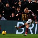 Hearts Liam Boyce scores his side's second goal of the game during the Ladbrokes Scottish Premiership match at Tynecastle Park, Edinburgh. Andrew Milligan/PA Wire.