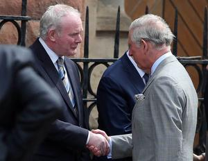 Prince Charles is greeted by First Minister Peter Robinson and Deputy First Minister Martin McGuinness St Patrick's Catholic Church on Donegal Street in Belfast City Centre as part of his trip to Ireland both North and South.   The church has been the focus of Orange Order parading issues in the last number of years.  Sinn Fein's Martin McGuinness follows up his meeting with the Queen by greeting Price Charles on his visit.