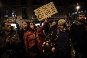 BARCELONA, SPAIN - JANUARY 07:  People gather showing their support for the victims of the terrorist attack at French magazine Charlie Hebdo, in front of the Consulate of France on January 7, 2015 in Barcelona, Spain. Twelve people were killed, including two police officers, as two gunmen opened fire at the magazine offices of Charlie Hebdo in Paris, France.   (Photo by David Ramos/Getty Images)