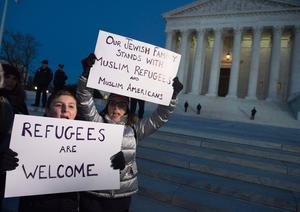 Demonstrators protest against US President Donald Trump and his administration's ban of travelers from 7 countries by Executive Order, during a rally outside the US Supreme Court in Washington, DC, on January 30, 2017. / AFP PHOTO / SAUL LOEBSAUL LOEB/AFP/Getty Images