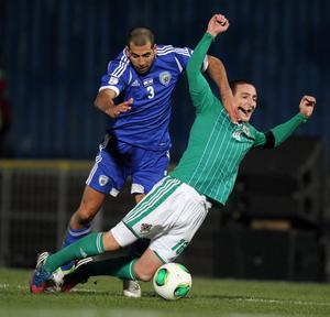 Northern Ireland's Martin Patterson with Israel's Tal Ben Haim during Tuesday night's World Cup qualifier at Windsor Park, Belfast