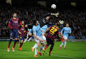 Barcelona's goalkeeper Victor Valdes struggles to claim the ball in a crowded area during the UEFA Champions League, Round of 16 match at the Etihad Stadium, Manchester. PRESS ASSOCIATION Photo. Picture date: Tuesday February 18, 2014. See PA story SOCCER Man City. Photo credit should read: Martin Rickett/PA Wire