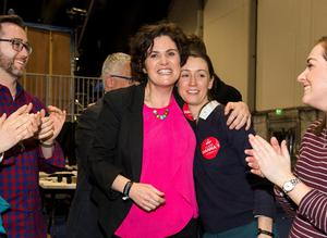 Newly elected MLA SDLP candidate for the Belfast West Claire Hanna, (centre) celebrates with supporters at the Titanic Exhibition Centre in the Northern Ireland Assembly Elections. Liam McBurney/PA Wire