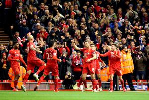 Liverpool's Jordan Henderson (no.14) celebrates scoring his sides first goal of the game with his team-mates during the Barclays Premier League match at Anfield, Liverpool. PRESS ASSOCIATION Photo. Picture date: Wednesday March 4, 2015. See PA story SOCCER Liverpool. Photo credit should read: Peter Byrne/PA Wire. RESTRICTIONS: Editorial use only. Maximum 45 images during a match. No video emulation or promotion as 'live'. No use in games, competitions, merchandise, betting or single club/player services. No use with unofficial audio, video, data, fixtures or club/league logos.