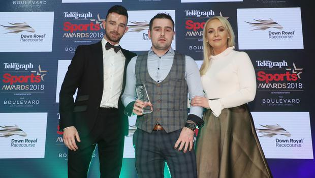 Proud brother: Michael Dunlop collects brother William's award from fellow bikes rider Glenn Irwin and Down Royal's Emma Meehan