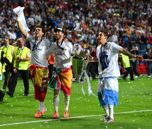 LISBON, PORTUGAL - MAY 24:  Pepe, Sergio Ramos and vÅngel Di Maria of Real Madrid celebrate victory after the UEFA Champions League Final between Real Madrid and Atletico de Madrid at Estadio da Luz on May 24, 2014 in Lisbon, Portugal.  (Photo by Shaun Botterill/Getty Images)
