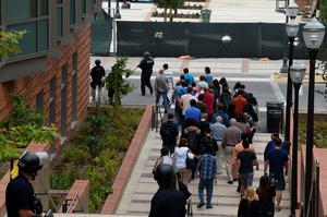 Security personnel escort people from the University of California Los Angeles campus after two people were confirmed dead following a shooting at the facility, June 1, 2016 in Los Angeles, California. Dozens of police cars and tactical response teams as well as federal agents rushed to the site as helicopters hovered overhead.  Some 43,000 students are enrolled at the massive UCLA campus, according to its website.   / AFP PHOTO / Robyn BECKROBYN BECK/AFP/Getty Images