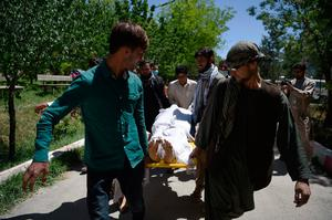 Afghan volunteers bring the body of a resident killed in a car bomb attack to the Wazir Akbar Khan hospital in Kabul on May 31, 2017.Photo: Wakil Kohsar, AFP/Getty Images