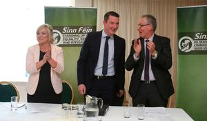 Sinn Fein leader for Northern Ireland Michelle O'Neill and MLA Gerry Kelly (right) congratulate John Finucane (centre), son of murdered solicitor Pat Finucane, after he was announced as the party's candidate for North Belfast in the upcoming Westminster election, at an election convention in Belfast. PA