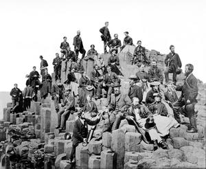 Belfast Naturalists' Field Club members on The Honeycomb at the Giants Causeway, Co. Antrim. This famous image was taken on Thursday morning 11 June 1868 by the wellknown photographic artist, Mr Mack, of Coleraine'. Courtesy of BNFC Archives