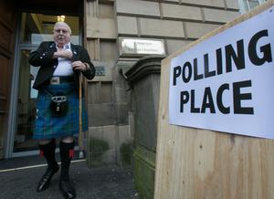 EDINBURGH, SCOTLAND - SEPTEMBER 18:  James Fraser leaves Lothian Chambers polling station having just voted in central Edinburgh on September 18, 2014 in Edinburgh, Scotland. After many months of campaigning the people of Scotland today head to the polls to decide the fate of their country. The referendum is too close to call but a Yes vote would see the break-up of the United Kingdom and Scotland would stand as an independent country for the first time since the formation of the Union.  (Photo by Matt Cardy/Getty Images)