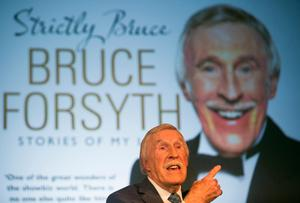 Sir Bruce Forsyth discussing his new book Strictly Bruce, at the Radio Times Festival on the Green at Hampton Court Palace in London. Daniel Leal-Olivas/PA Wire