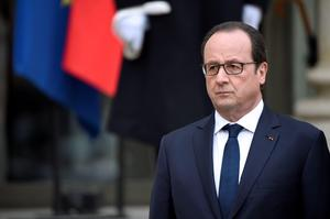 French president Francois Hollande addresses medias at the Elysee presidential palace after a meeting with Spanish royal couple, on March 24, 2015 at in Paris. Spanish King Felipe VI cut short his first state visit to France after 150 people died in a Germanwings airliner crash in the French Alps after earlier taking off from Barcelona.  AFP PHOTO / MARTIN BUREAUsMARTIN BUREAU/AFP/Getty Images