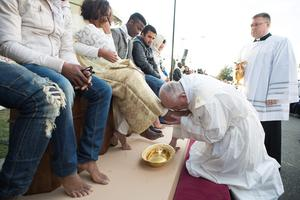 Pope Francis washes the foot of a woman during the foot-washing ritual at the Castelnuovo di Porto refugees center, some 30km (18, 6 miles) from Rome, Thursday, March 24, 2016. The pontiff washed and kissed the feet of Muslim, Orthodox, Hindu and Catholic refugees Thursday, declaring them children of the same God, in a gesture of welcome and brotherhood at a time when anti-Muslim and anti-immigrant sentiment has spiked following the Brussels attacks. (L'Osservatore Romano/Pool Photo via AP)