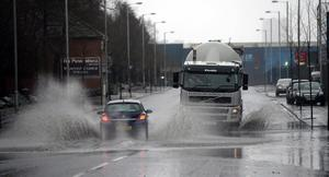Adverse conditions for drivers through the rain and puddles in Belfast this afternoon as the wet weather continued. Picture Charles McQuillan/Pacemaker.