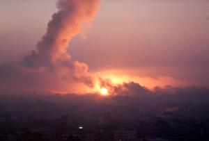 Smoke rises in the sky following Israeli strikes on eastern Gaza City, early Wednesday, July 30, 2014, amid Israel's heaviest air and artillery assault in more than three weeks of Israel-Hamas fighting. (AP Photo/Khalil Hamra)