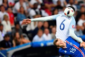 Iceland's forward Jon Dadi Bodvarsson and England's defender Chris Smalling (top) vie for the ball during the Euro 2016 round of 16 football match between England and Iceland at the Allianz Riviera stadium in Nice on June 27, 2016. / AFP PHOTO / BERTRAND LANGLOISBERTRAND LANGLOIS/AFP/Getty Images