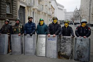 KIEV, UKRAINE - FEBRUARY 22:  Anti-government protestors guard the streets next to the Presidential offices on February 22, 2014 in Kiev, Ukraine. The offices of Ukrainian President Viktor Yanukovych have been left unguarded, with the protesters in full control of the streets surrounding the government district. The opposition have called for elections to take place on May 25 and demanded that President Yanukovych stand down immediately. (Photo by Jeff J Mitchell/Getty Images)