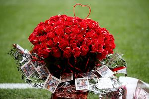 Roses are placed on the side of the pitch before the last memorial service to be held at Anfield, Liverpool, to mark 27 years to the day since the tragedy claimed 96 lives. PRESS ASSOCIATION Photo. Picture date: Friday April 15, 2016. The 96 Liverpool fans died in the crush on the Leppings Lane terraces at Sheffield Wednesday's Hillsborough stadium after going to see their team play Nottingham Forest in an FA Cup semi-final on April 15, 1989. See PA story MEMORIAL Hillsborough. Photo credit should read: Peter Byrne/PA Wire
