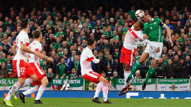 Northern Ireland's Gareth McAuley (right) and Switzerland's Manuel Akanji battle for the ball during the 2018 World Cup Qualifying Play-Off, First Leg match at Windsor Park, Belfast. PRESS ASSOCIATION Photo. Picture date: Thursday November 9, 2017. Niall Carson/PA Wire