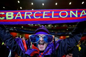 A Barcelona supporter show his support during the UEFA Champions League match at the Emirates Stadium, London. Adam Davy/PA Wire