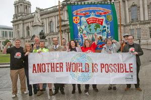 Handout photo of the new Banner unveiled for G8 protest at Belfast City Hall which will lead the Belfast G8 protest on Saturday organised by the Northern Ireland Committee of the Irish Congress of Trade Unions. PRESS ASSOCIATION Photo. Picture date: Tuesday June 11, 2013. See PA story ULSTER G8. Photo credit should read: Kevin Cooper/NIC-ICTU/PA Wire NOTE TO EDITORS: This handout photo may only be used in for editorial reporting purposes for the contemporaneous illustration of events, things or the people in the image or facts mentioned in the caption. Reuse of the picture may require further permission from the copyright holder.