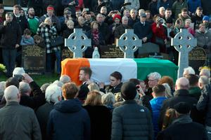 The son of former Northern Ireland Deputy First Minister Martin McGuinness, Emmet McGuinness (centre left) helps to carry the coffin of his father on it's way for burial at the City Cemetery of Derry on March 23, 2017.   Former Irish Republican Army commander turned peace negotiator Martin McGuinness divided opinion both in life and in death but on Thursday his supporters gave him the funeral of an Irish chieftain. / AFP PHOTO / Paul FAITHPAUL FAITH/AFP/Getty Images