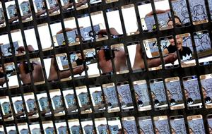 Smartphones of the electronic company Samsung are displayed after a press conference at the company's stand at the IFA 2015 tech fair in Berlin, Germany, Thursday, Sept. 3, 2015. (AP Photo/Michael Sohn