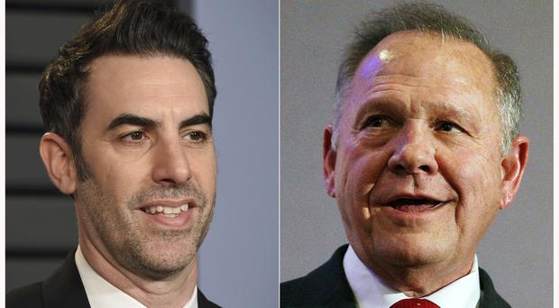 Sacha Baron Cohen, left, and Roy Moore (AP)