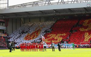 LIVERPOOL, ENGLAND - APRIL 13:  The Liverpool and Manchester City players acknowledge a minutes silence for the Hillsborough victims on the 25th anniversary of the tragedy prior to the Barclays Premier League match between Liverpool and Manchester City at Anfield on April 13, 2014 in Liverpool, England.  (Photo by Alex Livesey/Getty Images)
