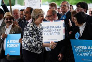 SOLIHULL, UNITED KINGDOM - JUNE 07:  Prime Minister Theresa May greets supporters as she arrives for her last campaign visit at the National Conference Centre on June 7, 2017 in Solihull, United Kingdom. Britain goes to the polls tomorrow to vote in a general election.  (Photo by Carl Court/Getty Images)