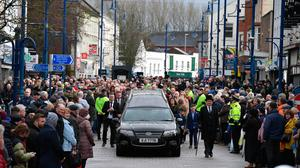 Well wishers and mourners line the streets as the funeral of former Manchester United and Northern Ireland footballer Harry Gregg takes place on February 21, 2020 in Coleraine, Northern Ireland.  (Photo by Charles McQuillan/Getty Images)