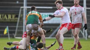 Tyrone's Ben McDonnell and David Clifford of Kerry scuffle on the ground. Credit: INPHO/Bryan Keane