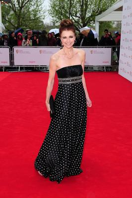 Emma Samms arriving for the 2013 Arqiva British Academy Television Awards at the Royal Festival Hall, London. PRESS ASSOCIATION Photo. Picture date: Sunday May 12, 2013. See PA story SHOWBIZ Bafta. Photo credit should read: Ian West/PA Wire