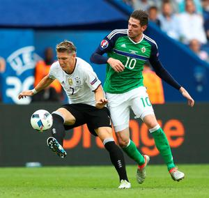 FILE - JUNE 21, 2016: Bastian Schweinsteiger makes record 15th appearance for Germany at Euro finals on June 16, 2016 PARIS, FRANCE - JUNE 21:  Bastian Schweinsteiger of Germany and Kyle Lafferty of Northern Ireland compete for the ball during the UEFA EURO 2016 Group C match between Northern Ireland and Germany at Parc des Princes on June 21, 2016 in Paris, France.  (Photo by Clive Mason/Getty Images)