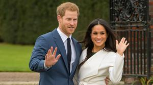 Prince Harry and Meghan Markle in the Sunken Garden at Kensington Palace, London, after the announcement of their engagement (Dominic Lipinski/PA)