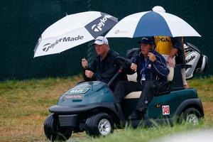 LOUISVILLE, KY - AUGUST 08:  Bob Sowards of the United States rides in a cart with his caddie near the clubhouse during the weather-delayed second round of the 96th PGA Championship at Valhalla Golf Club on August 8, 2014 in Louisville, Kentucky.  (Photo by Sam Greenwood/Getty Images)