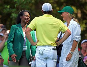 Condoleezza Rice, left, former Secretary of State and Augusta National member, laughs with Rory McIlroy, center, and his girlfriend Caroline Wozniacki on the sixth tee box during the par-three contest before the Masters golf tournament, Wednesday, April 10, 2013, in Augusta, Ga. Wozniacki caddied for McIlroy. (AP Photo/Atlanta Journal-Constitution, Curtis Compton)  MARIETTA DAILY OUT; GWINNETT DAILY POST OUT; LOCAL TV OUT; WXIA-TV OUT; WGCL-TV OUT